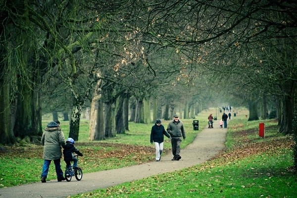 People walking on an autumn day in Cassiobury Park