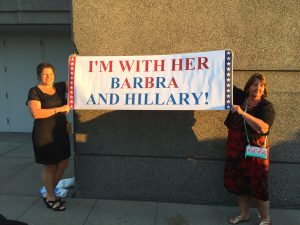 Two concert-goers at Chicago's United Center show their support for Barbra (and Hillary Clinton).
