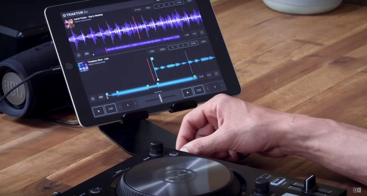 Traktor DJ 2 running on an iPad next to a Kontrol S2 MK3