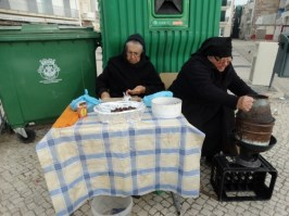 Old women selling roasted chestnuts