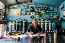 Crest Divers shop owner Sue Newson filling out her dive log - Jervis Bay ©Danielle Ryan - Bluebottle Films Oct 2014