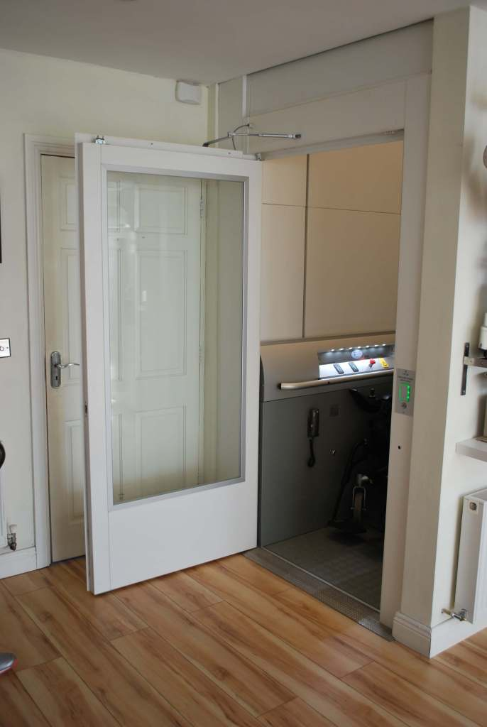Enclosed lift from ground floor living space to first floor accessible suite