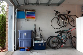 """Sports"" side of the garage. Some storage bins and more stuff... not an efficient use of space."