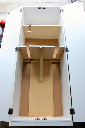 Cabinet mods with spare wood. Cutaways to hang long things and wood reinforcement to carry the weight.