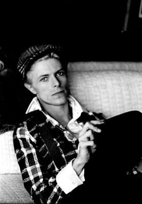 David Bowie relaxing at his home in Los Angeles in 1975
