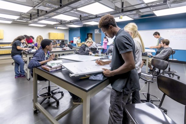 The Physics Lab was designed for maximum flexibility. It is equipped with a VA pipe grid to hang experiments, moveable lab furniture and flooring depicting a meter grid to make measurements quick and easy.