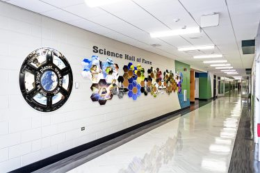 Each year, one exceptional science student is honored by being inducted into the Science Hall of Fame. The new wall graphics bring a sense of history to this accolade.