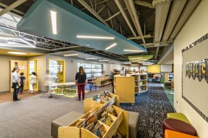 Cohorts and different zones throughout the school are identified by color. In the media center, and other shared spaces like the project space and the presentation space, all colors come together and suggest a sense of community.