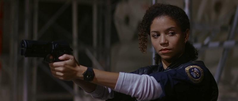 Sarah Fielding (Gloria Reuben) draws her handgun.