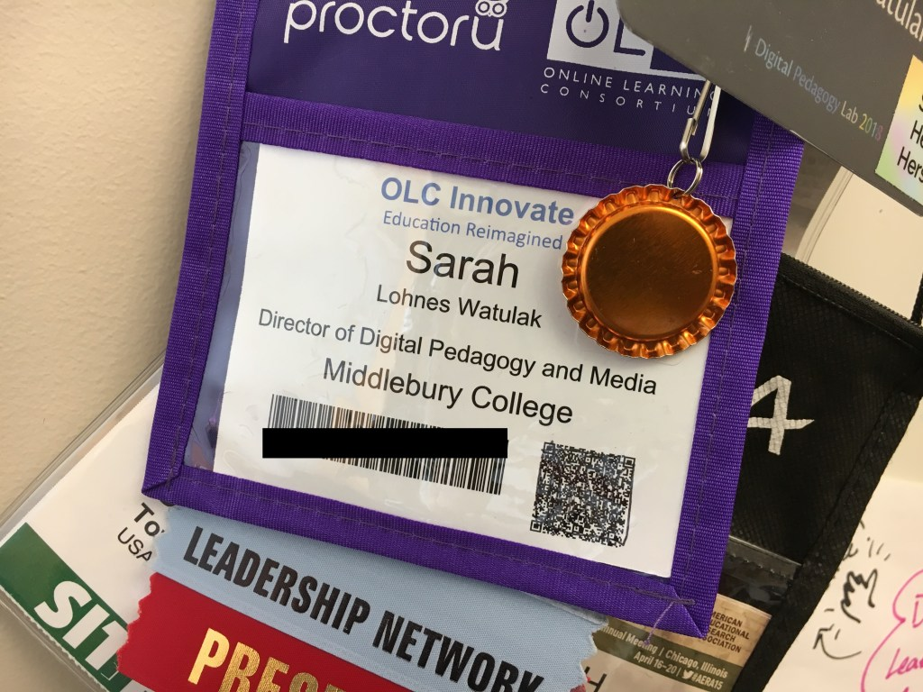 conference badges hanging on whiteboard