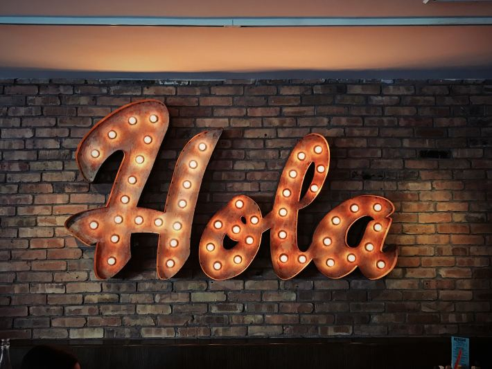 led lights spelling the word Hola