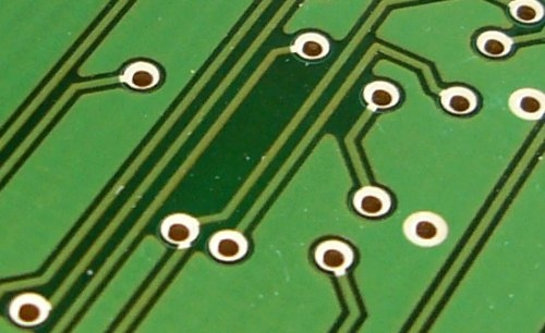 Circuit Traces And Vias On A Green Circuit Board