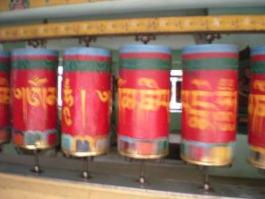 Spinning prayer wheels at the Dalai Lama's temple complex in Dharamsala, Himachal Pradesh, India.