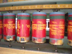 Spinning prayer wheels at the Dalai Lama's temple complex in Dharamsala, Himachal Pradesh, India.