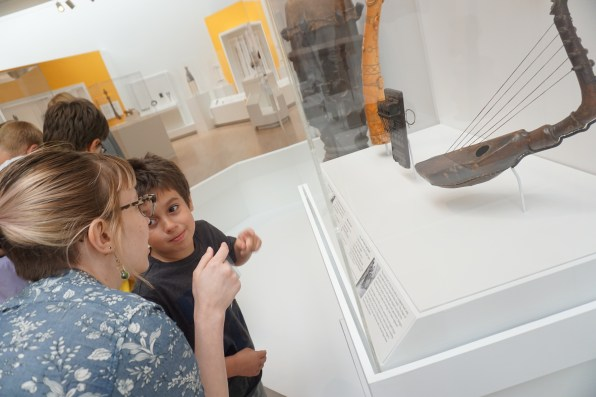 Kristin and a camper investigate art in the African Galleries.