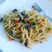 HOME COOKING | Tomatoes, mushrooms, green onions, a dash of pepper tossed with olive oil and into pasta make a tasty vegetarian pasta!