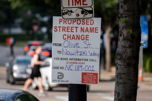 A sign at Olive Street and North Houston Street gives notice of a proposed renaming of Olive Street in honor of Dirk Nowitzki.