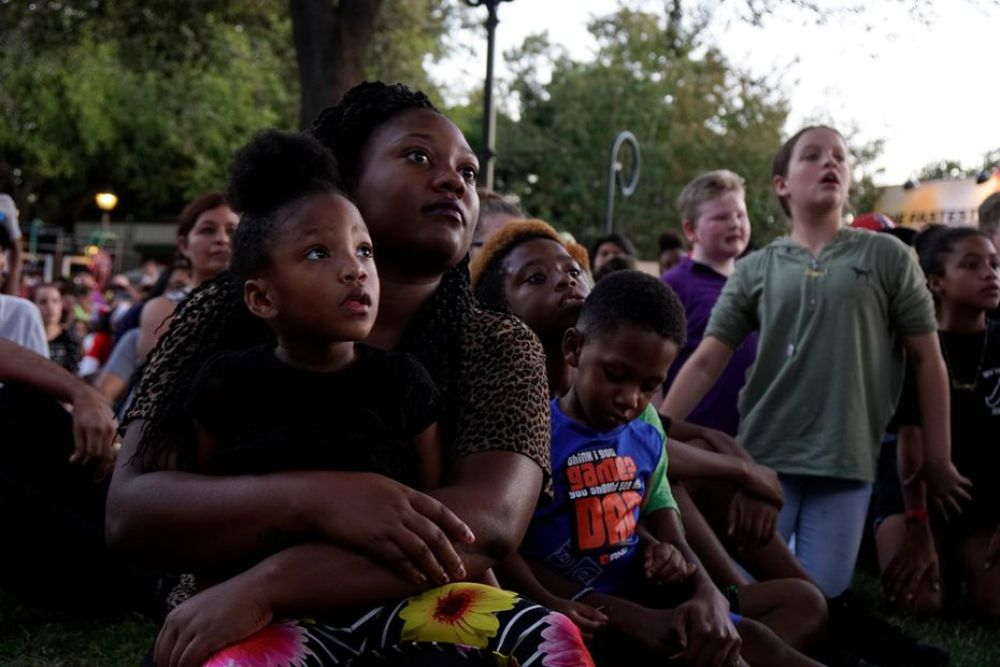 Journee Tripp and her mom Kendall Tripp check out the zombies and ghouls during the opening show at Six Flags Over Texas' 2017 Fright Fest in Arlington. Families with young children are encouraged to attend Fright Fest during the day; scarier activities begin after dark.