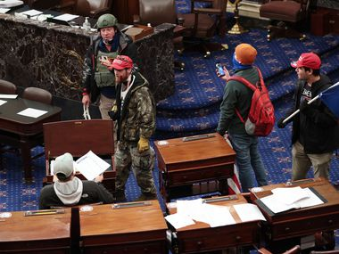 Air Force veteran Larry Brock Jr. confirmed to The New Yorker magazine that this widely circulated image from Wednesday's shocking scene in the U.S. Senate chamber shows him in the upper left, wearing combat gear.
