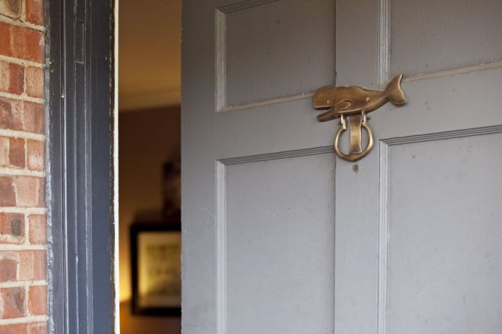 Visitors to Lilly Neubauer's Midway Hollow home get a sense of the quirky decor from the moment the knock on the front door with a whale knocker.