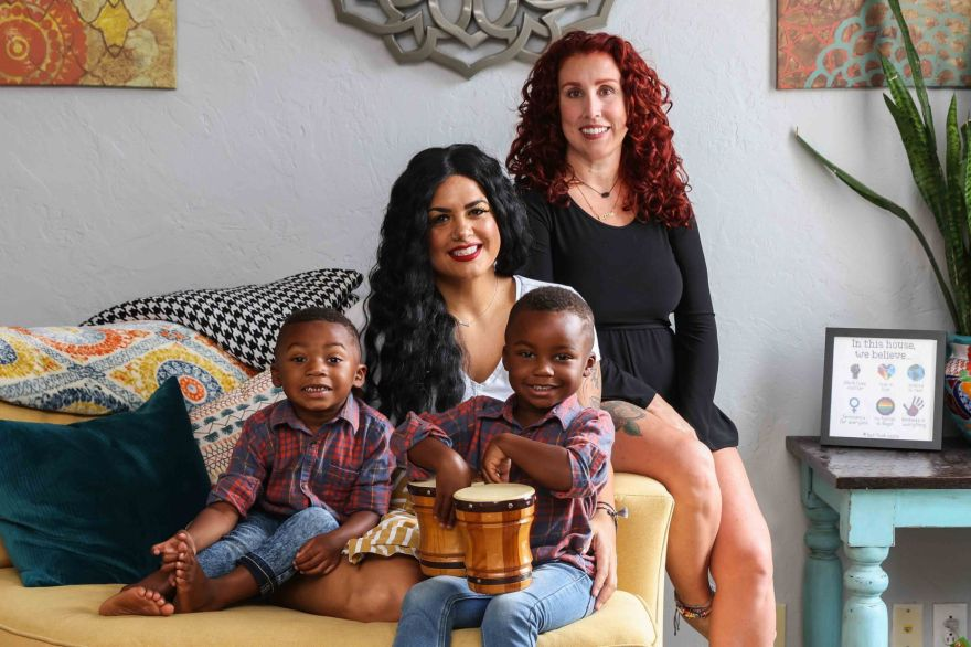 Jantzen Verastique (center), her children Lukah, 3, and Jonah, 4, pose for a portrait with Dondi Morse.