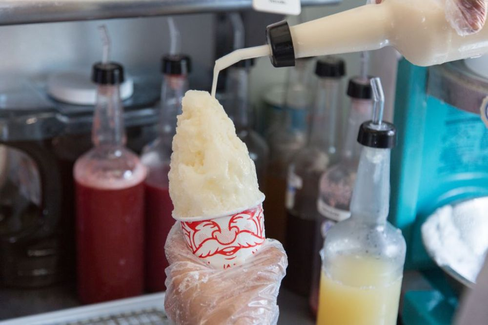 A shaved ice is being made with homemade syrup which includes organic sugars and natural flavors at Gnome Cones, Friday, May 26, 2017, in Argyle, Texas.