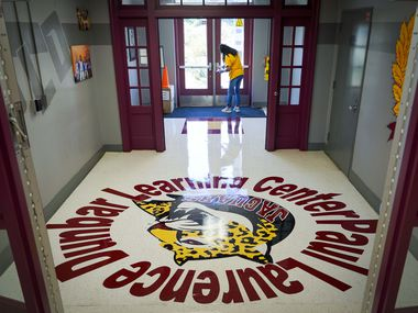 Custodian Debra Booty disinfected high-touch areas recently at Paul L. Dunbar Learning Center in Dallas.