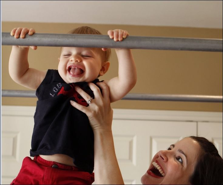Being quarantined at home to beat a spreading virus is an opportunity to do wonderful, life-affirming tasks, Watchdog columnist Dave Lieber says. In this 2009 photo, Ashley Cooley played with her son Quincy at home.