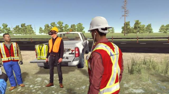 "Once putting on the VR headset, the trainee is immersed in the virtual four-lane highway project for a site flyover and a pre-shift ""huddle"" with coworkers."