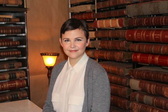 Ginnifer in the archives with books behind her.