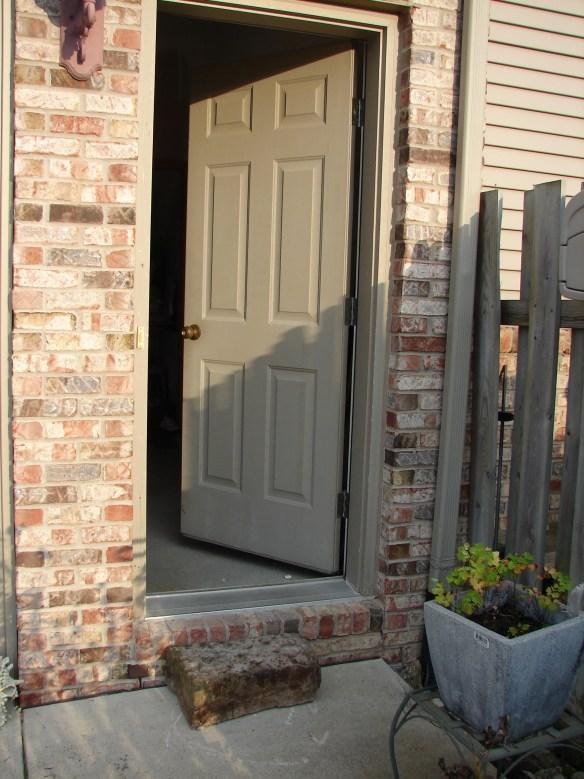 Nicholas Speaks cabin step my door.jpg