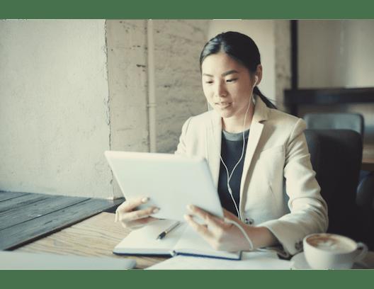 young woman looking at a tablet at DNA Digital Marketing