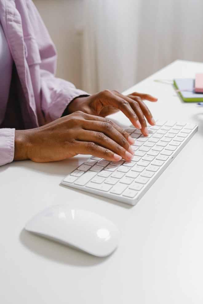 black entrepreneur typing on convenient wireless keyboard