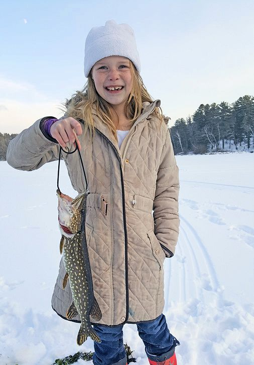 The girls were seasoned anglers by 5 years old and catching some nice fish on their own. - Photo credit: DNR