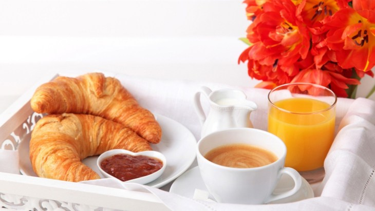 Breakfast-Croissants-Bagels-Plate-Juice-Orange-Juice-Coffee-Cappuccino-Milk-Cups-Glasses-Flowers-Tulips-1152x2048