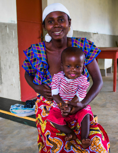 """Diane Nzeyimana and his son Lievin (1 years 3 months). She said that care group volunteers are of great importance.""""My son has better health than its big brothers and sisters when they were the same age.""""she now knows how to prevent illness of his child, being careful hygiene of her child,she knows also about family planning and its balanced diet."""