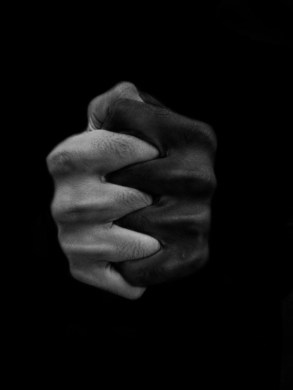 clasped hands of multiethnic people
