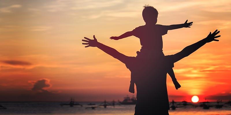 Dad and son enjoying sunset