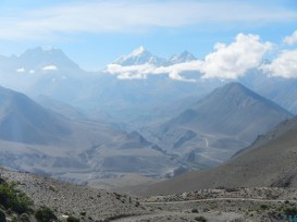 View across the other side of the valley towards the Thorang Lar Pass (5415m) - the large U-shape in the background