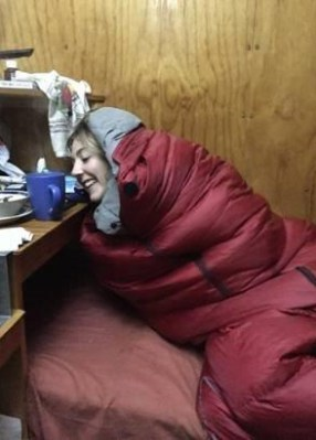 Volunteer Chelsie Reynolds wakes up to the cold.