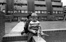 Reporton Road estate, Hammersmith, London: children on a wall posing for the photographer