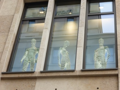 mannequins in store window