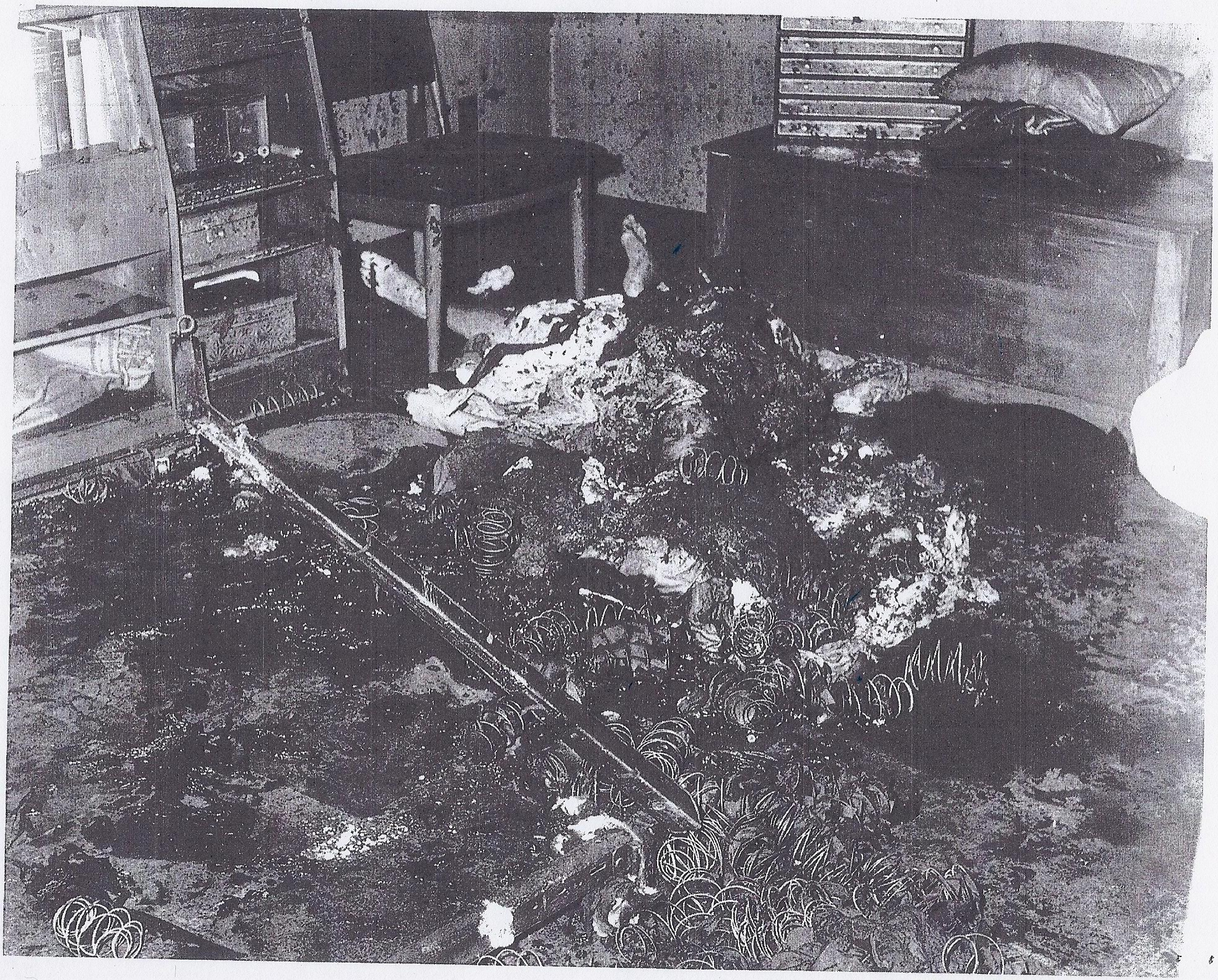 Wide shot of bedroom after the smoke cleared