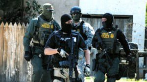 Drug Enforcement Administration Special Agents leave a housef Friday, Sept. 23, 2011, in Roswell, N.M., as part of an investigation that included the arrest of dozens of suspected drug traffickers Friday. (AP Photo/Roswell, Daily Record, Mark Wilson)
