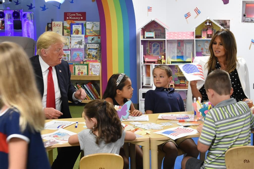 President Trump and First Lady Melania visit the Nationwide Children's Hospital in Columbus. They draw with kids and leave crisis behind him.