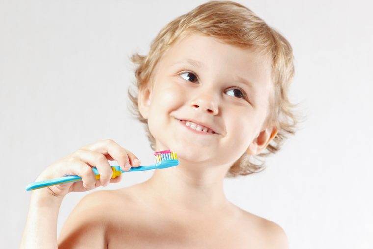 brushing teeth with fluoride toothpaste