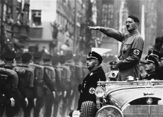 Adolf Hitler and Heinrich Himmler review SS troops during Reich Party Day ceremonies. (September 1938)