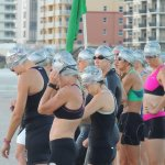 Participants wait patiently for start of swim portion of the triathlon.