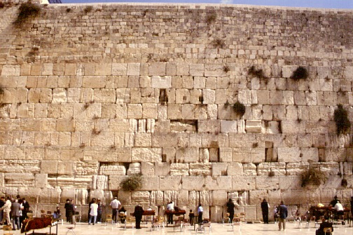 """This is the holiest shrine of the Jewish world. The Western Wall is part of the retaining wall supporting the temple mount built by Herod in 20 B.C. After the destruction of the Second Temple in 70 A.D., Jews were not allowed to come to Jerusalem until the Byzantine period, when they could visit once a year on the anniversary of the destruction of the Temple and weep over the ruins of the Holy Temple. Because of this, the wall became known as the """"Wailing Wall."""""""