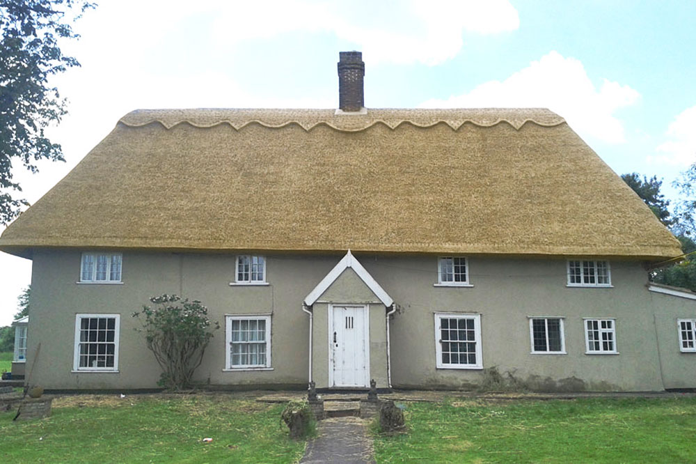 Vintage Cottage With Completed Long Straw Thatch